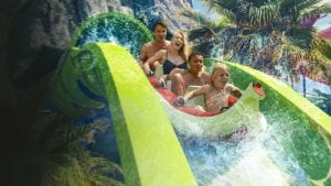 Family on waterslide at Volcano Bay