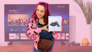 An Xfinity customer holds a Flex box.