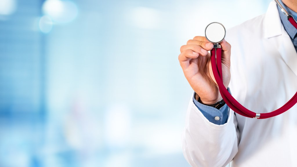 A doctor holds a stethescope.